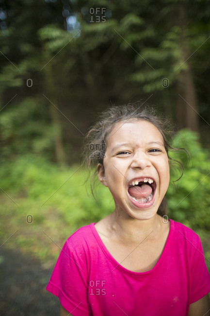Photograph of screaming girl sitting alone