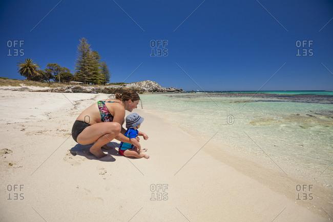 Mother and baby son enjoying sandy beach, Yallingup, Western Australia, Australia