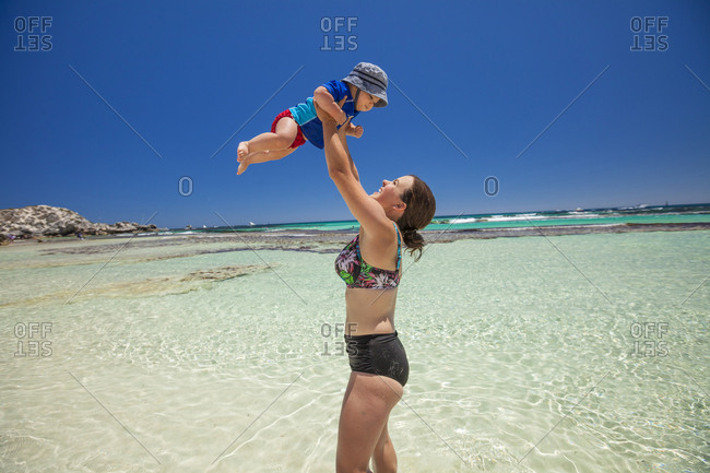 Mother and baby son enjoying coastal beach, Yallingup, Western Australia, Australia