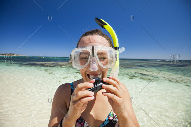 Woman wearing snorkels and swimming goggles, Perth, Western Australia, Australia