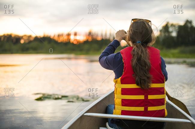 Canoeing on Burnaby Lake, British Columbia.