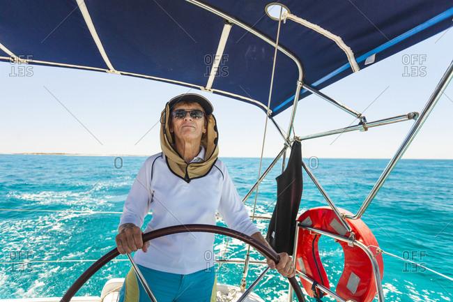 Senior woman on sailboat enjoying the day