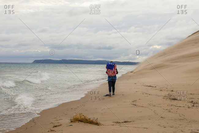 Woman hiking along Sleeping Bear Dunes National Lakeshore, Empire, Michigan, USA