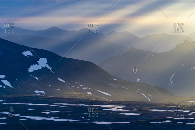 Sunbeams over mountains, Mutnovsky, Kamchatka Peninsula, Russia