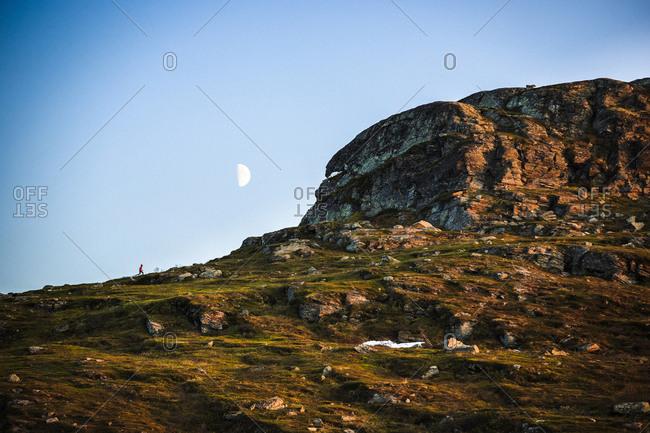 Distant view of person trail running, Ammarnaes, Vasterbotten, Sweden