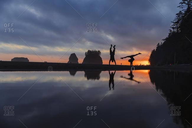 Couple exercising at Shi Beach, La Push, Washington, USA