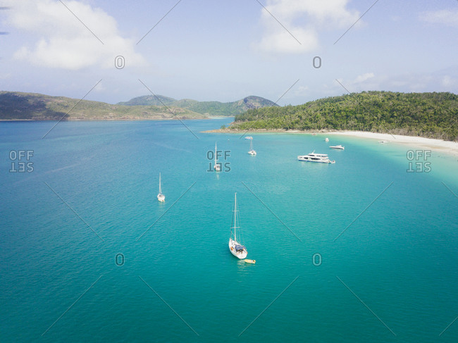 Australia, Queensland, Whitsundays - November 29, 2017: Incredible turquoise lagoon with white boats in Whitsundays beach, Australia