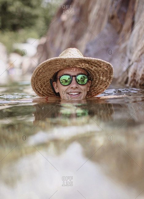 Portrait of young woman swimming in Emerald Pools, California, USA