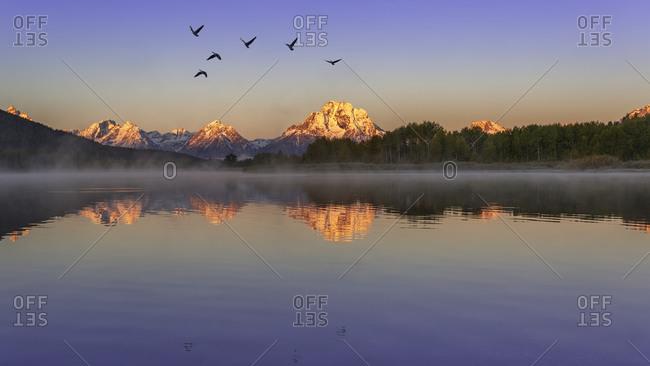 Teton Range reflecting in Snake River, Grand Teton National Park, Wyoming, USA