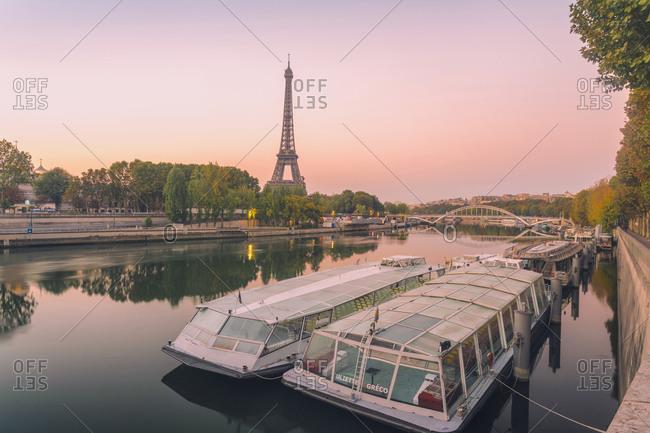 France, Ile de France, Paris - October 15, 2017: Eifel tower with the Seine river by sunrise