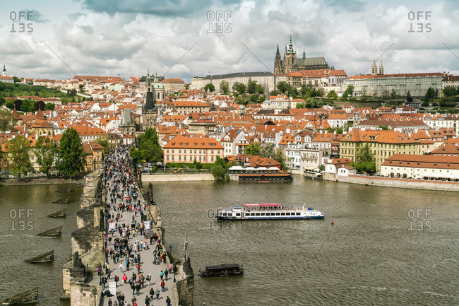 Czech Republic, Praha, Prague - May 9, 2017: View from Charles bridge with statues with the Prague Castle and St. Vitus Cathedral in the background