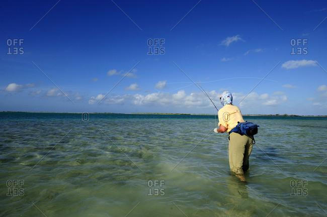 Man fly-fishing in sea, Christmas Island