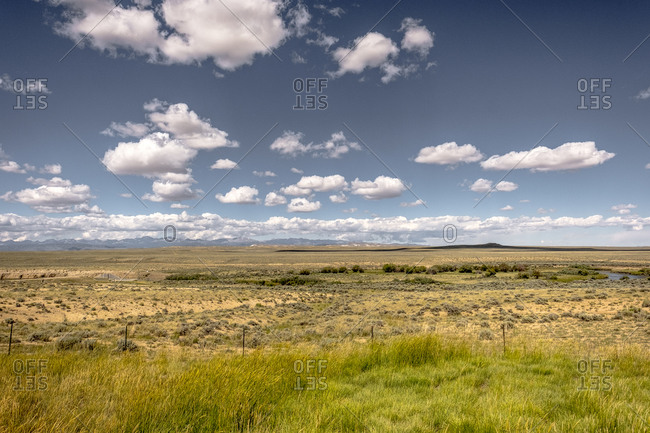 Clouds over tranquil prairie, Wyoming, USA