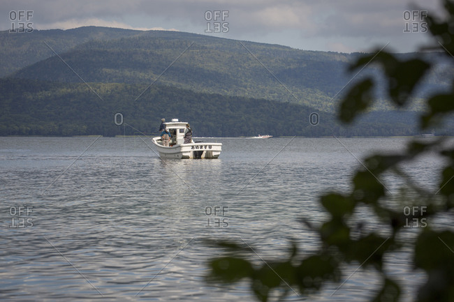 Japan, Hokkaido, Lake Akan - September 16, 2017: People fishing from boat on Lake Akan, Hokkaido, Japan