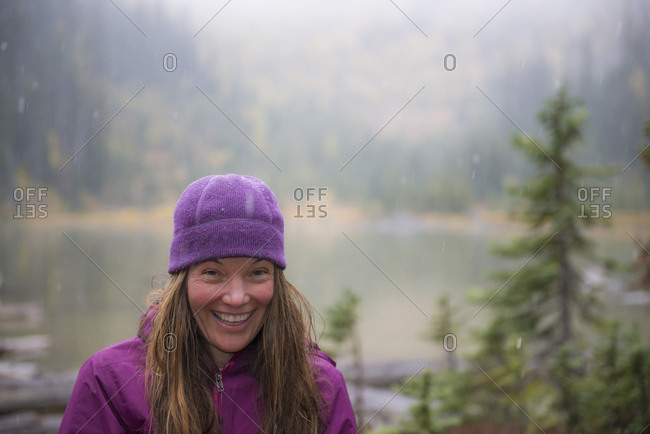 Smiling female hiker in Wilderness in autumn, Washington State, USA