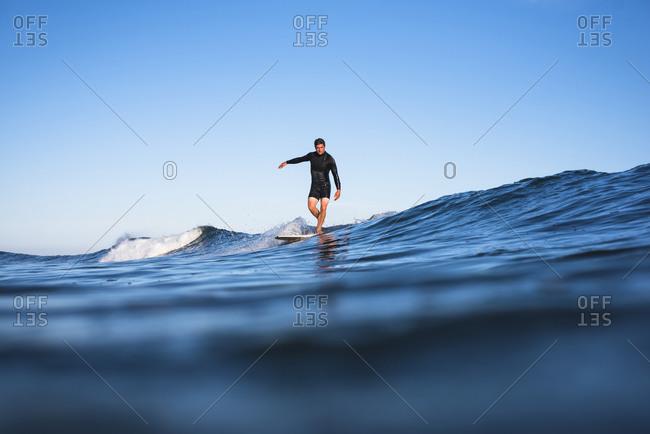 Surfer riding wave, Narragansett, Rhode Island, USA