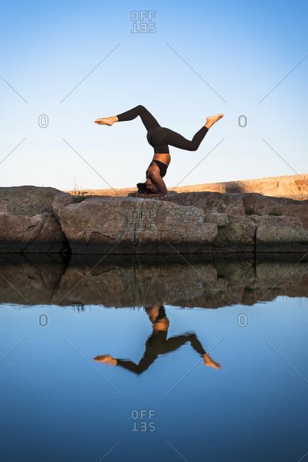 Woman in sportswear doing yoga, Narragansett, Rhode Island, USA