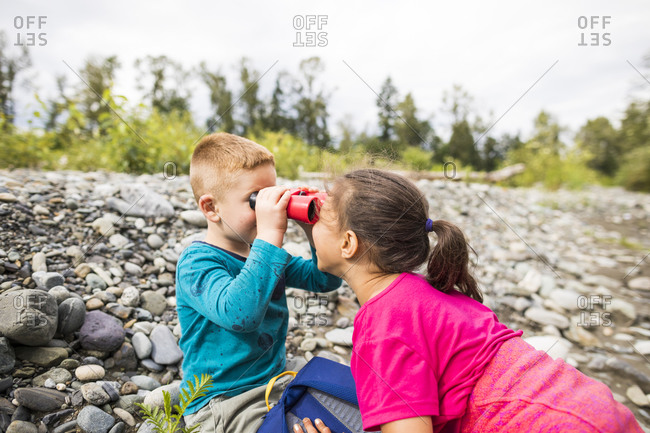 Two children playing while hiking