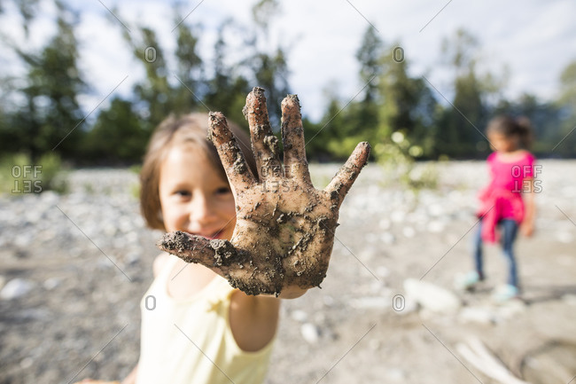 Girl showing dirty hand from hard work