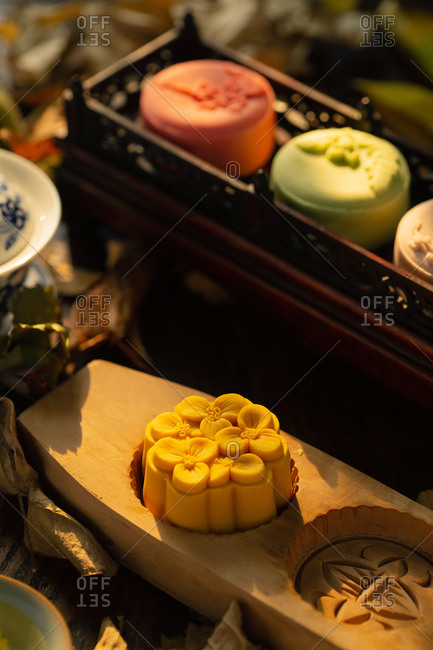 Yellow moon cake with a flower design
