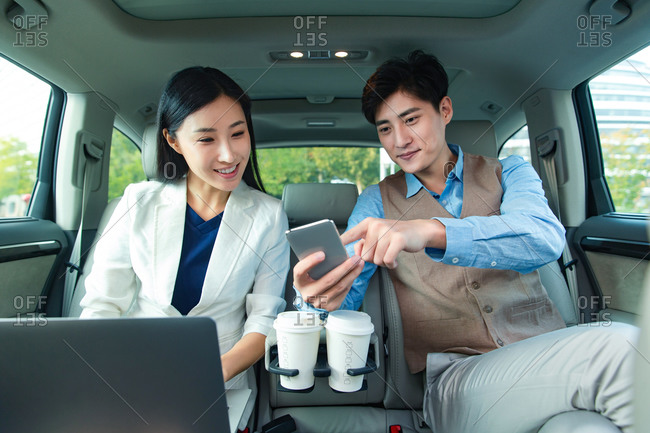 Business people see a tablet in the car