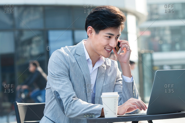 Businessman working outside on a sunny day