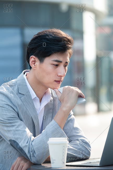 Businessman working outdoors on a nice day