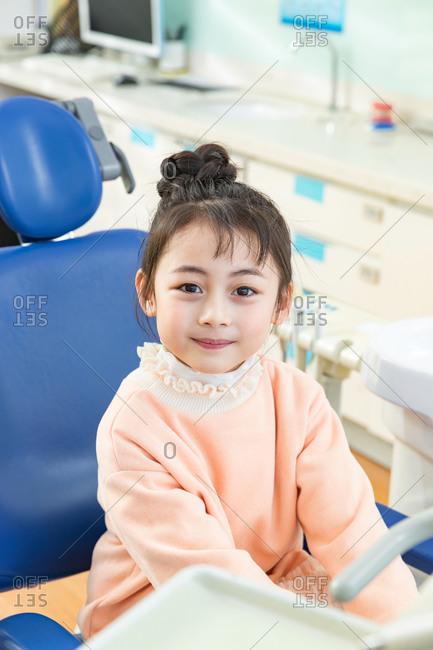Lovely little girl in dental clinic