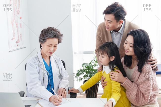 Woman doctor examining her patients