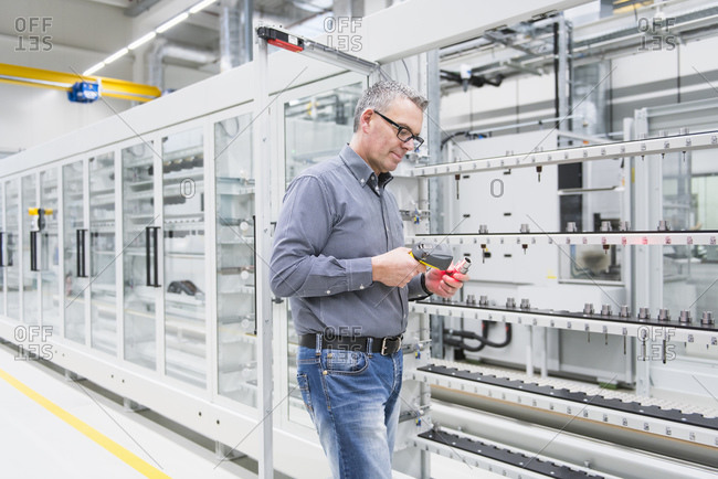 Man using barcode scanner on a product in a factory
