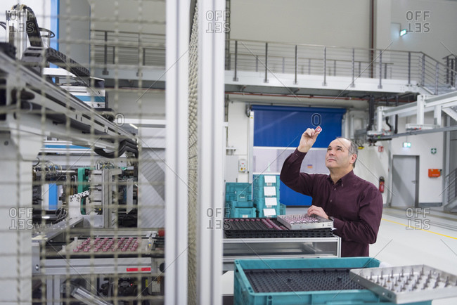 Man examining product in a factory