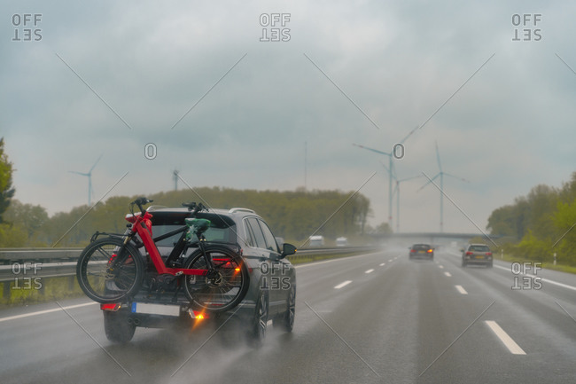 Motorway during rain- car with bike rack