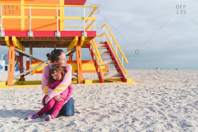 Loving mother embracing daughter at Miami beach- Florida- USA