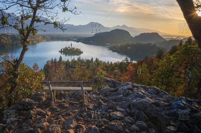 Slovenia- Upper Carniola- Bled- Empty bench overlooking Bled Island at foggy dawn