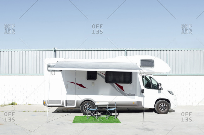 Folding chairs set in front of parked motor home