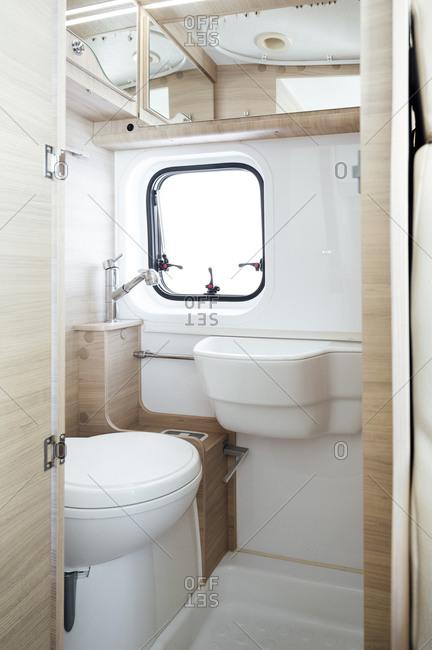 Small white bathroom inside motor home