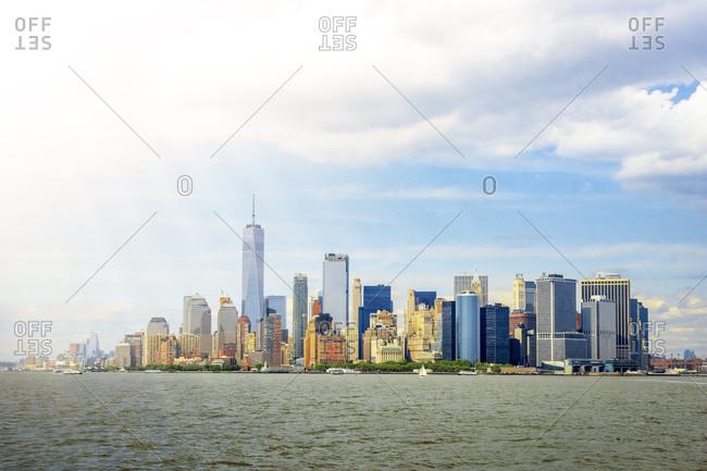 USA- New York- New York City- Sunlight illuminating Manhattan skyline