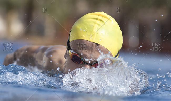 Determined swimmer swimming in pool at tourist resort- Dubai- United Arab Emirates