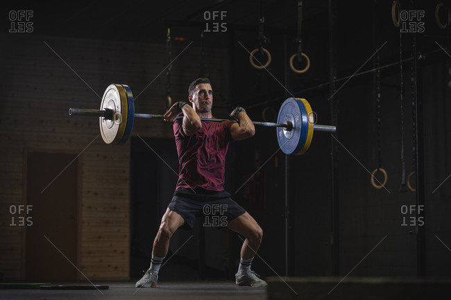 Man doing overhead squat exercise at gym