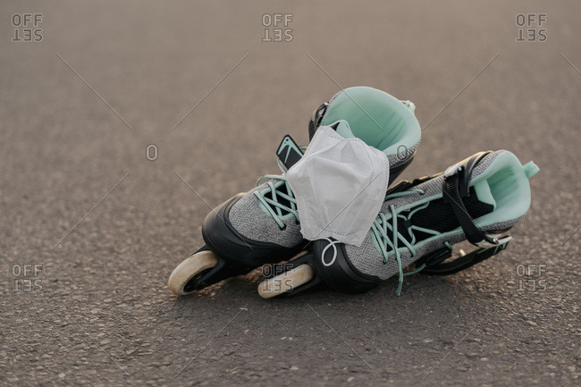 Close-up of face mask on inline skates on at skateboard park