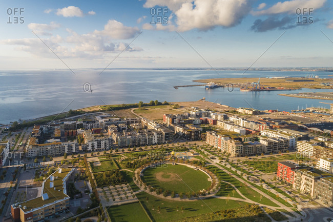 Sweden- Scania- Malmo- Aerial view of park at Vastra Hamnen with sea in background