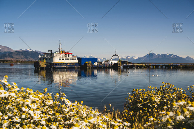 Chile- Ultima Esperanza Province- Puerto Natales- Ferry docked in coastal harbor