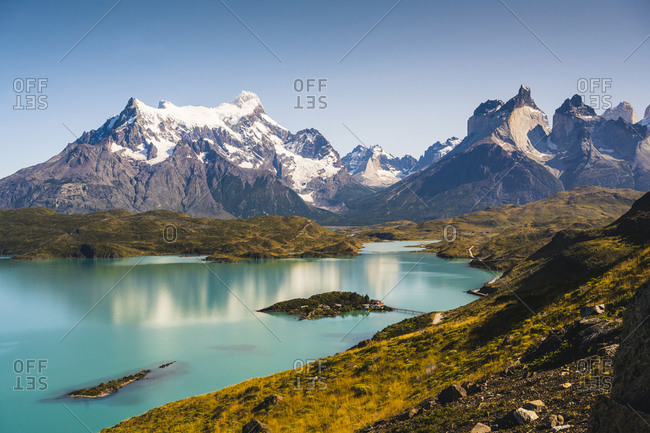 Chile- Scenic view of turquoise lake in front of Cordillera Paine mountain group