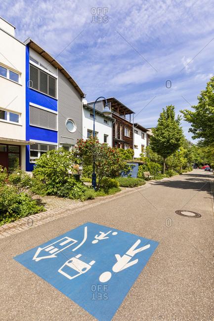 Germany- Baden-Wurttemberg- Freiburg im Breisgau- Children at play road marking in modern suburb