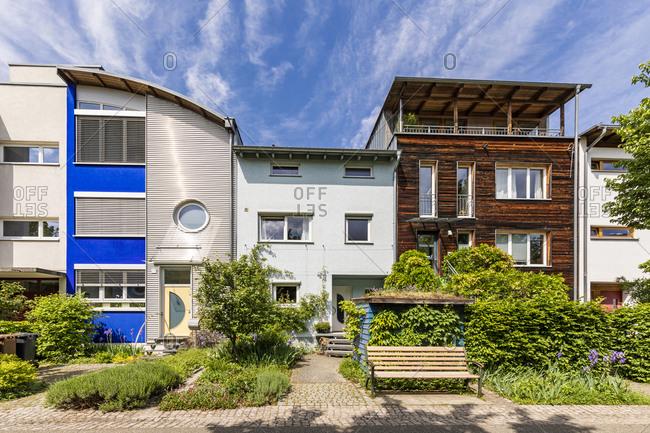 Germany- Baden-Wurttemberg-FreiburgimBreisgau- Row of modern suburb houses in spring
