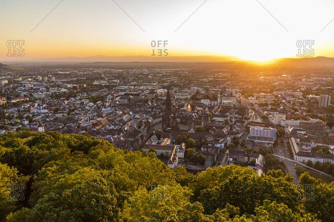 Germany- Baden-Wurttemberg- Freiburg im Breisgau- Sunset over city seen from summit of Schlossberg hill