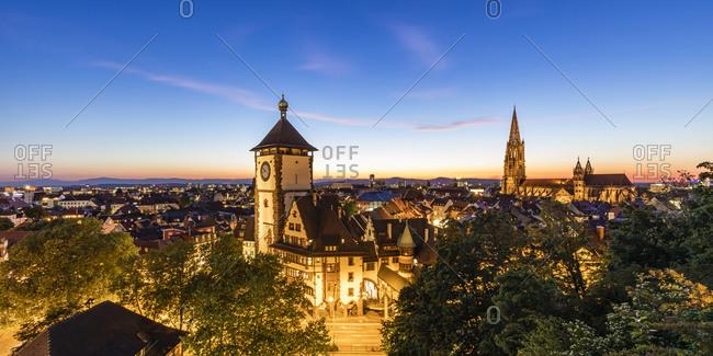 Germany- Baden-Wurttemberg- Freiburg im Breisgau- Panorama of illuminated Schwabentor gate at dusk