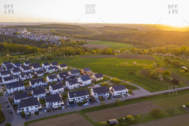 Germany- Baden-Wurttemberg- Waiblingen- Aerial view of modern suburb at sunset