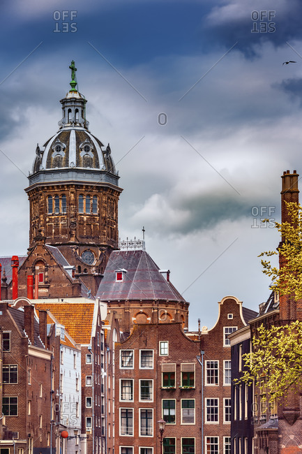Netherlands- North Holland- Amsterdam- Old town houses in front of Basilica Of Saint Nicholas