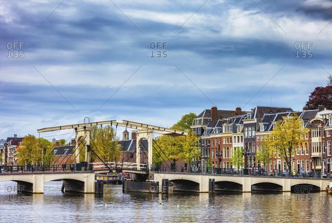Netherlands-North Holland- Amsterdam- Clouds over Skinny Bridge